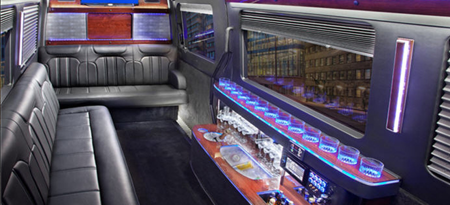 Mercedes Sprinter interior luxury seating with purple lights