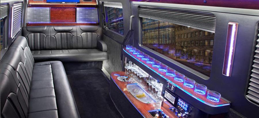Mercedes Sprinter interior luxury seating with purple lights